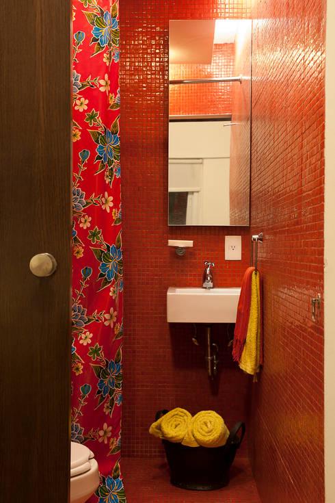 Departamento Roma Oaxaca : Baños de estilo  por Germán Velasco Arquitectos