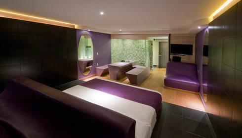 Hotel MaxIntimo : Recámaras de estilo moderno por DIN Interiorismo