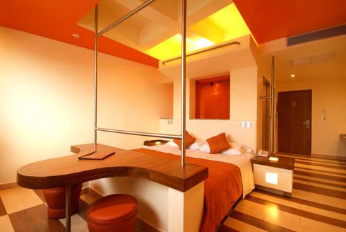Hotel Cuore: Recámaras de estilo moderno por DIN Interiorismo