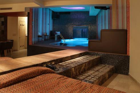 Hotel Pirámides  Valle : Recámaras de estilo moderno por DIN Interiorismo