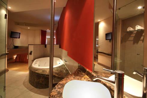 Hotel Sens : Baños de estilo  por DIN Interiorismo