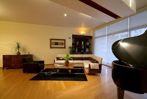 Departamento Chelu : Salas de estilo moderno por DIN Interiorismo
