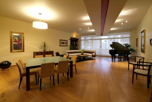 Departamento Chelu : Comedores de estilo moderno por DIN Interiorismo