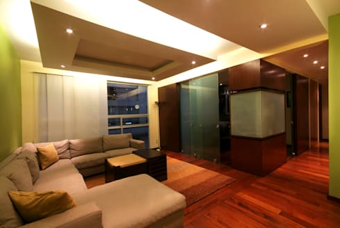 Departamento Viniegra: Salas de estilo moderno por DIN Interiorismo