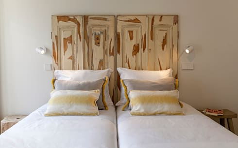 Old windows headboard: Quarto  por Home Staging Factory