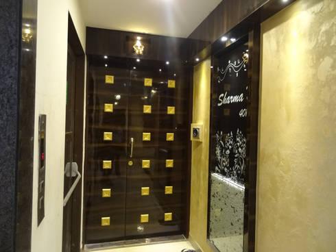Mr.Gunjan Sharma:  Corridor & hallway by UNIQUE DESIGNERS & ARCHITECTS