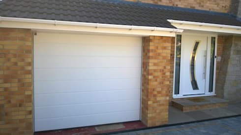 Hormann sectional garage door with matching Hormann front entrance ...