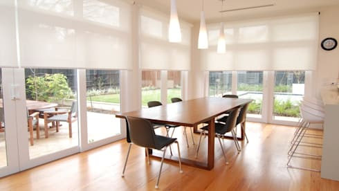 Enrollable: Hogar de estilo  por Escuadra Arquitectura C.A