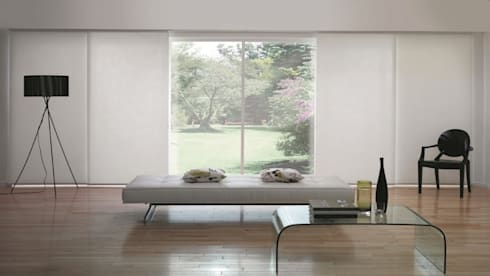 Panel: Hogar de estilo  por Escuadra Arquitectura C.A