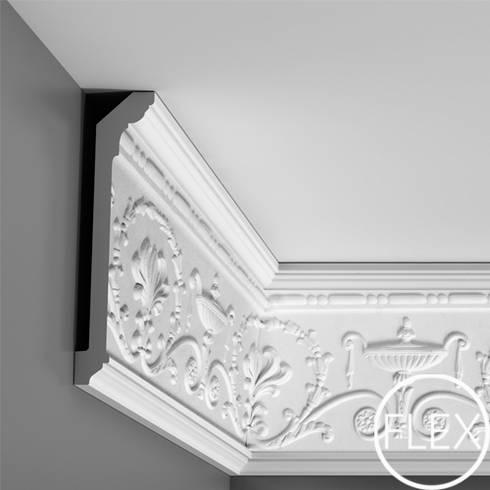 Molduras: Paredes y pisos de estilo moderno por Escuadra Arquitectura C.A