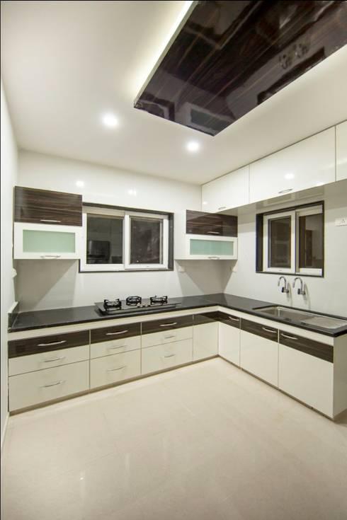Cozinhas minimalistas por ARK Architects & Interior Designers