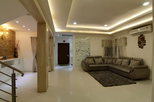 Living area view from Dinning: eclectic Living room by KREATIVE HOUSE
