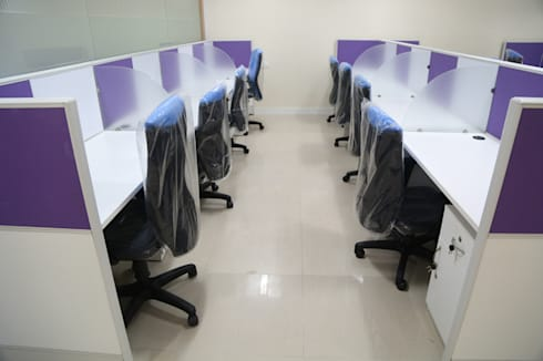 Commercial Projects: modern Study/office by xcubeinteriors