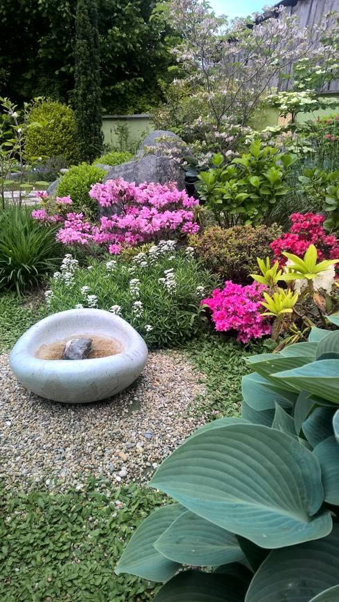 Jardines de estilo ecléctico por Neues Gartendesign by Wentzel