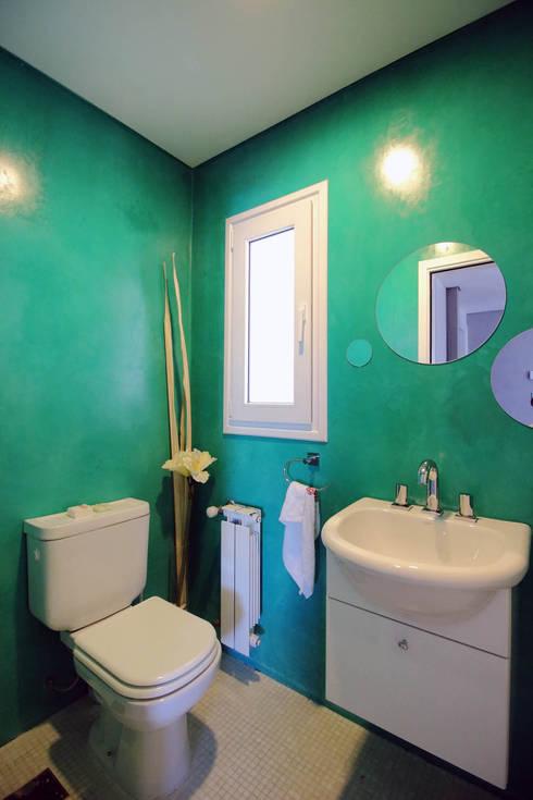 Casa Storni: Baños de estilo  por Queixalós.Trull Arquitectos