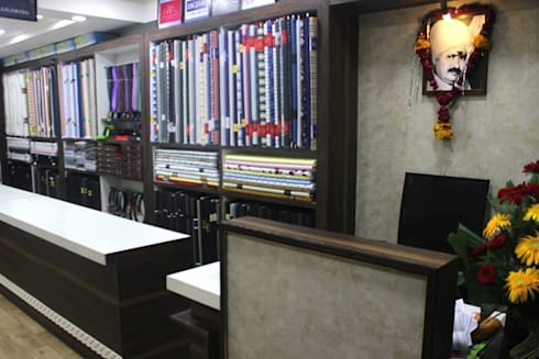 Prabhat's men's botique n designer studio: modern Study/office by Legend Interiors