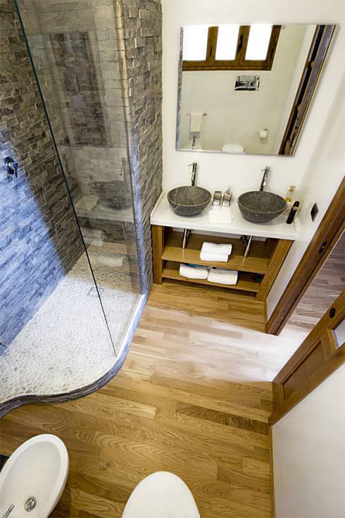 Banheiros  por Salvo Lombardo Architetto