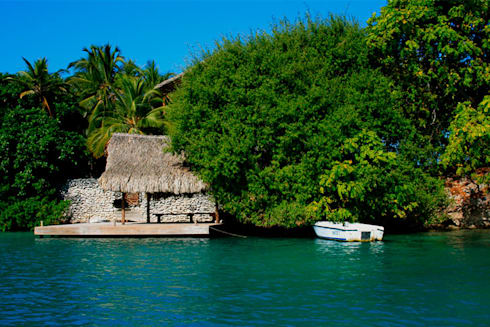 Isla Única Cartagena: Casas de estilo tropical por Kubik Lab