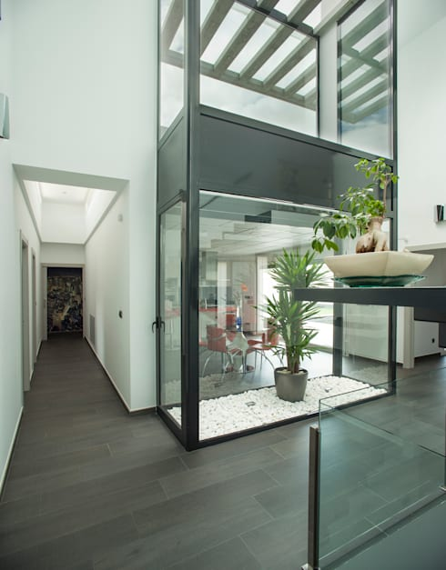 Casa AI: Pasillos y vestíbulos de estilo  de Mascagni arquitectos