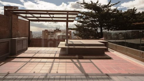 Antes y Después de este increíble Pent-House con terraza. :  de estilo  por ARCE S.A.S
