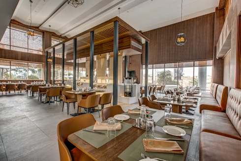 Little Italy Pune: tropical Dining room by Aijaz Hakim Architect [AHA]