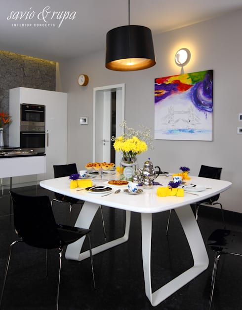 Modern White Dining Table:  Dining room by Savio and Rupa Interior Concepts
