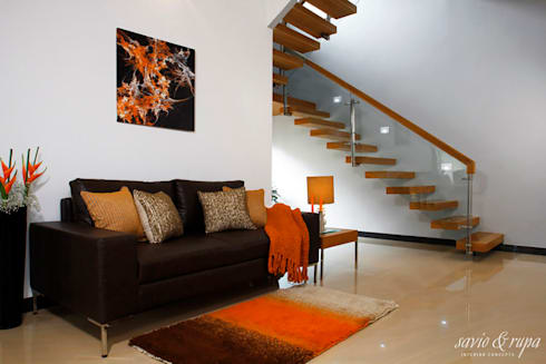 Cantilevered Staircase: modern Corridor, hallway & stairs by Savio and Rupa Interior Concepts