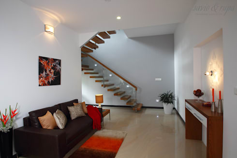 Family room: modern Living room by Savio and Rupa Interior Concepts