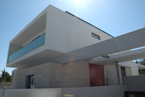 Casa AF: Casas minimalistas por BLK-Porto Arquitectura