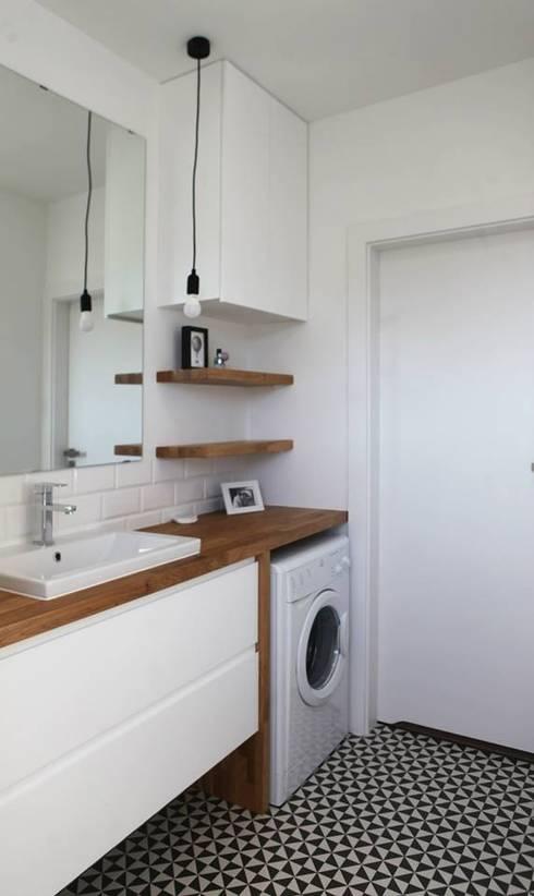 Salle de bains de style  par Schemat