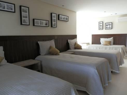 Casa de Hóspedes - Depois: Quartos  por MBDesign Arquitetura & Interiores