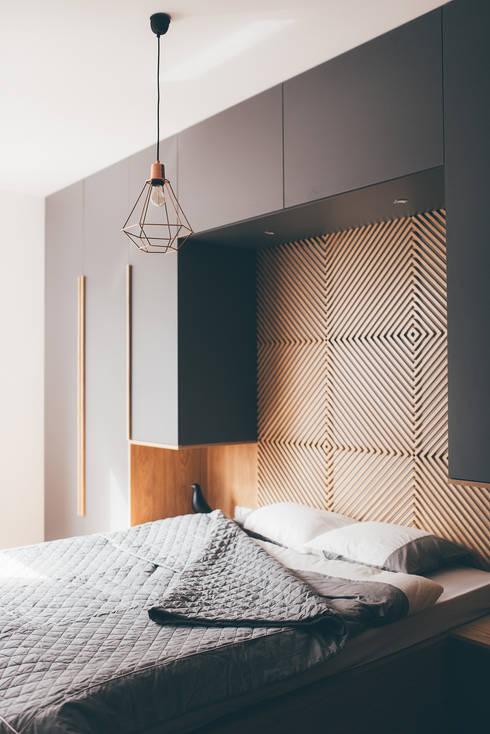 projekt aranżacji apartamentu w Gdyni: styl , w kategorii Sypialnia zaprojektowany przez em2