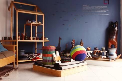Area de Showroom: Espacios comerciales de estilo  por Additivo al diseño