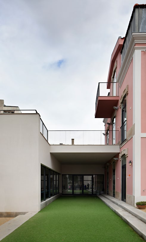 ​Kindergarten and Nursery : Casas  por es1arq