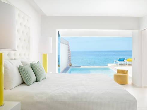 Grecia . Interdesign: Hotéis  por Interdesign Interiores