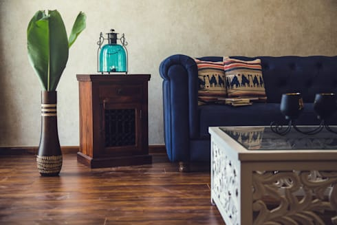 Cozy House: classic Living room by Intraspace