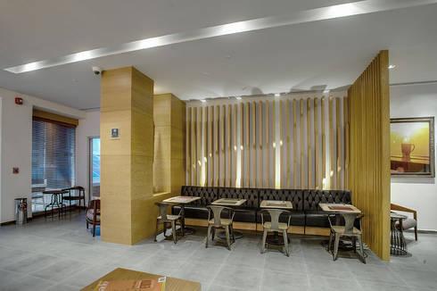 Restaurante EATERY  y Deli Café  TOASTINA, Hotel FOUR POINTS by Sheraton:  de estilo  por Art.chitecture, Taller de Arquitectura e Interiorismo 📍 Cancún, México.
