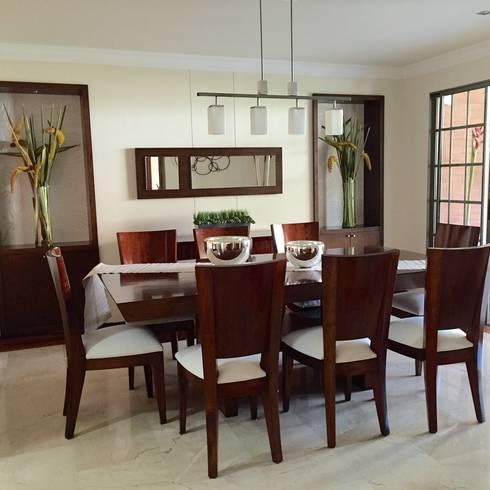 Comedor Casa en la Ciudad: Comedores de estilo clásico por ea interiorismo
