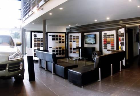 Local Porsche: Oficinas y tiendas de estilo  por Arquitectura Visual
