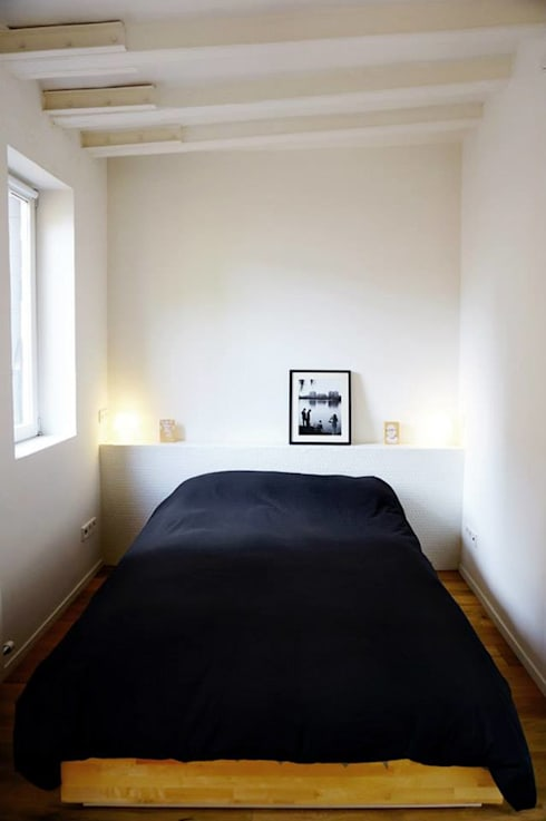 Parlament: Dormitorios de estilo  de mcd/studio