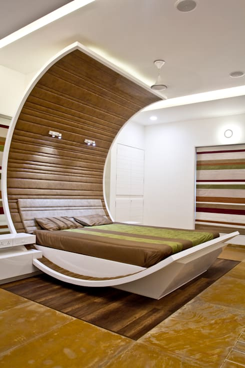 Interiors at Rajhans Maxima apartments,Surat:  Bedroom by Hundreddesigns