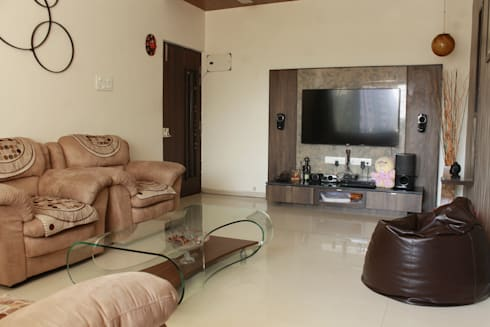MR. ASHWINBHAI PATEL RESIDENCE: modern Living room by INCEPT DESIGN SERVICES