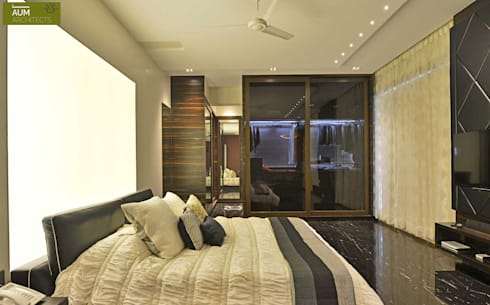Duplex Apartment design: modern Bedroom by Aum Architects