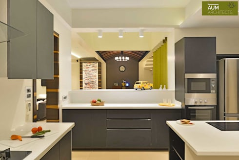 Duplex Apartment design: modern Kitchen by Aum Architects