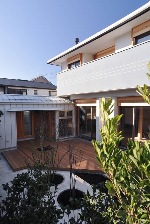 バスケットボールのできる家: (株)独楽蔵 KOMAGURAが手掛けた庭です。