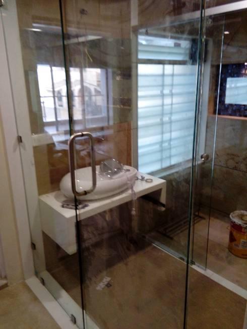 Dr varia residence: modern Bathroom by Tameer studio