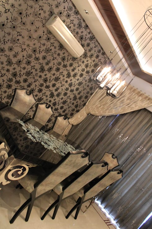 Mrs. Jaspreet Panesar: classic Dining room by Designworks