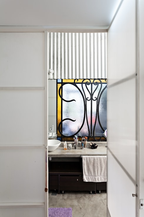 Baños de estilo  por Pop Arq