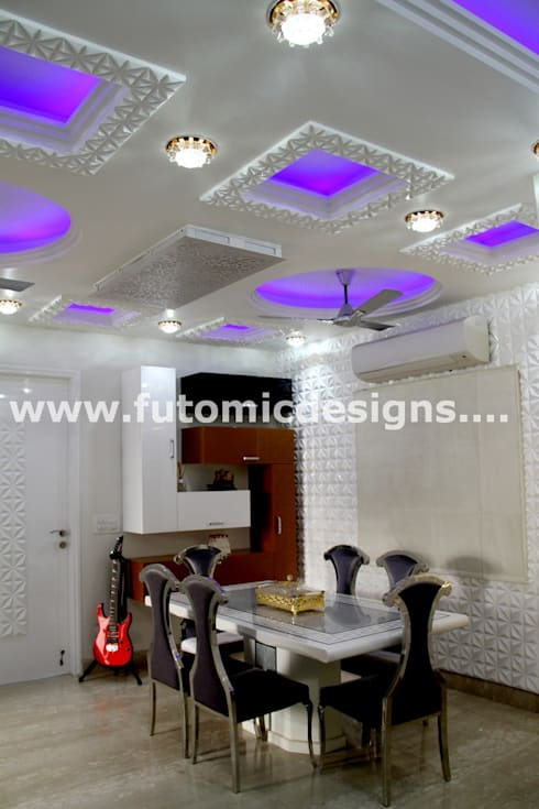 Premium Home Interiors:  Dining room by Futomic Design Services Pvt. Ltd.