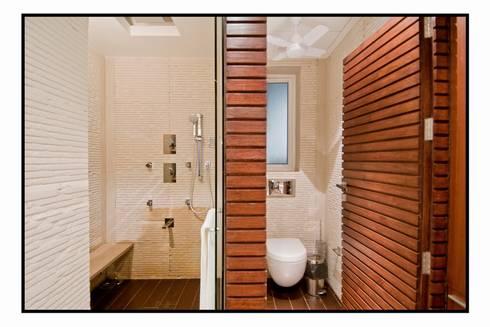 Residence 1: modern Bathroom by Dynamic Designss